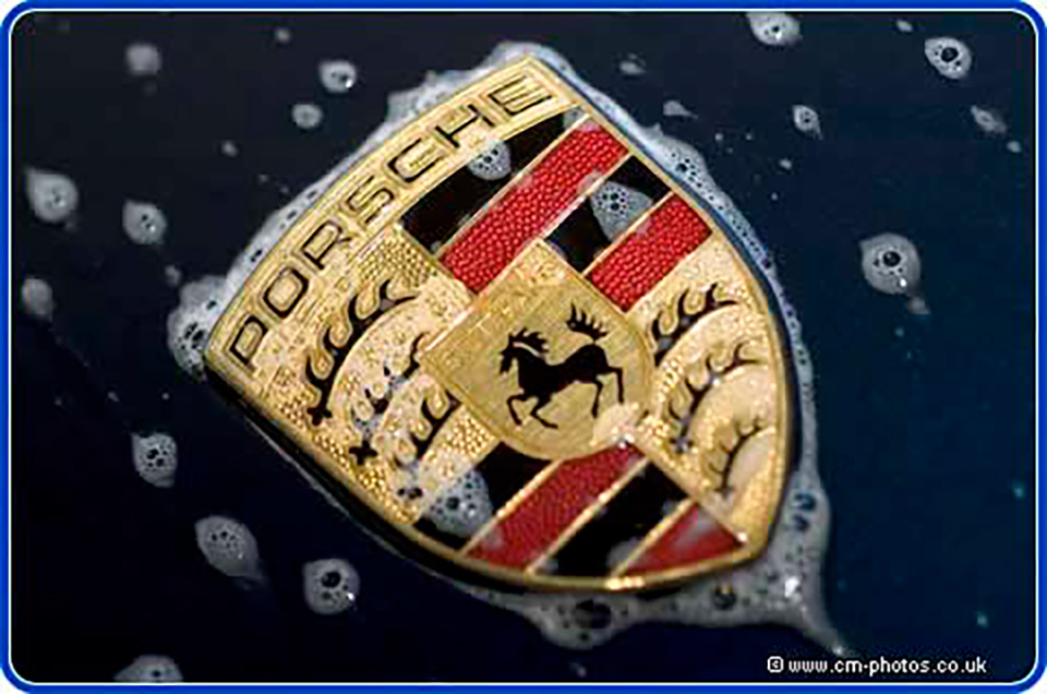 Porsche badge covered in soap