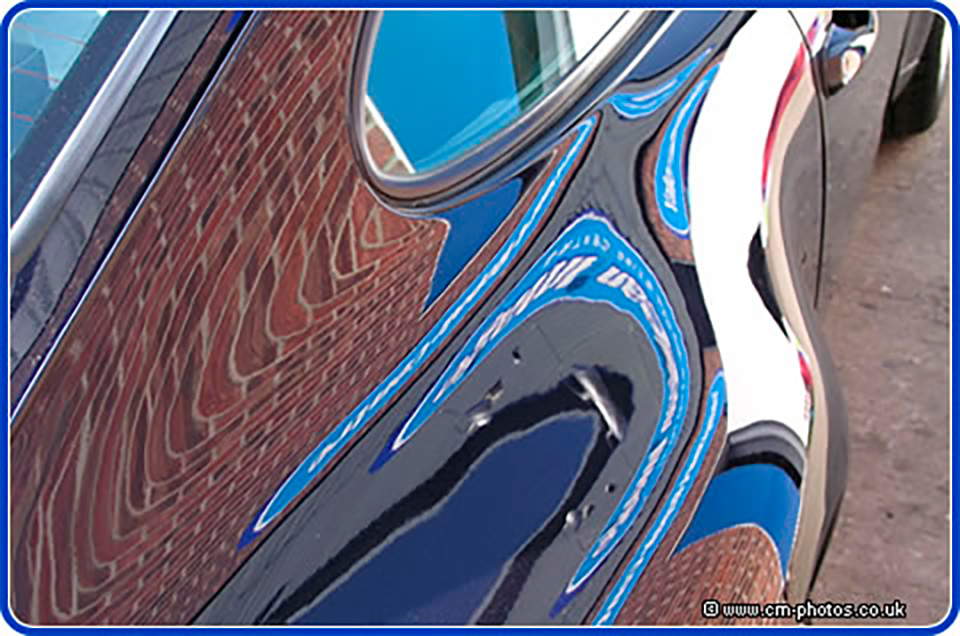 Reflections on polished Porsche.